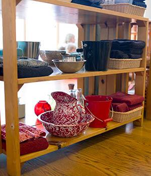 An shelf full of organized items helps foster inner order for children.
