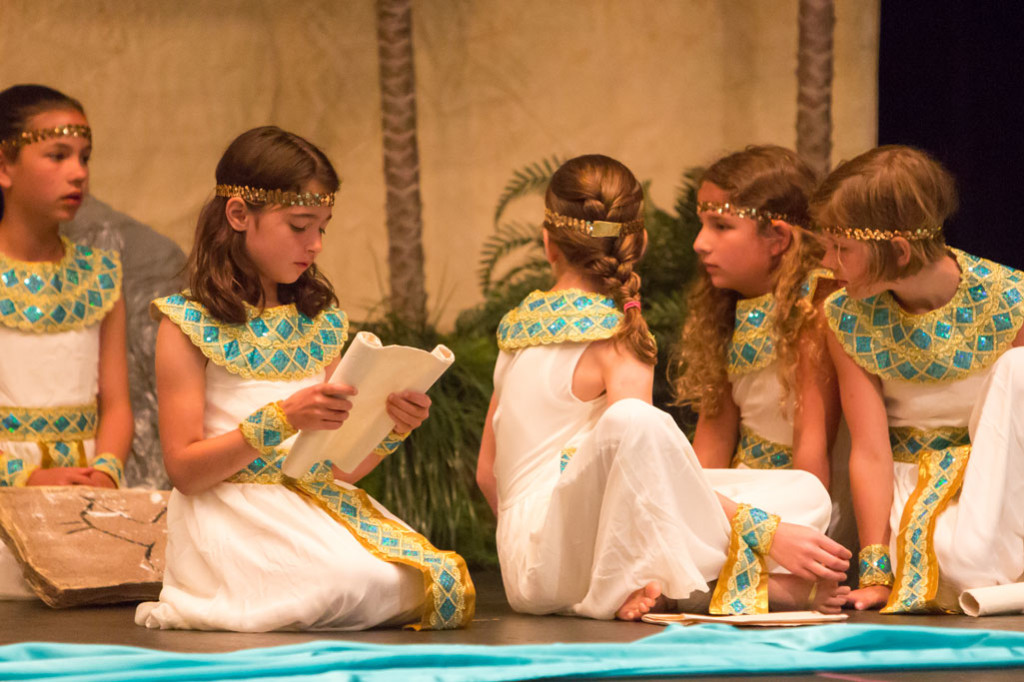 Montessori students perform a play.