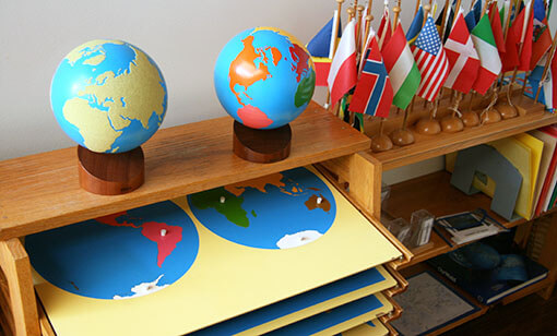 Globes and maps in a Forest Bluff School classroom representing Montessori materials