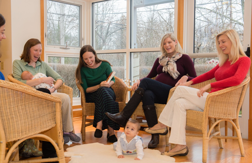 Happy group of parents at parenting classes.