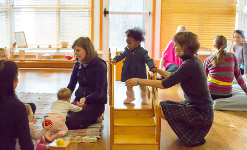 Teachers leading parenting classes with small children