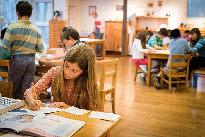 A girl works on a project in her classroom while learning emotional balance