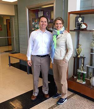 Paula Preschlack stands with Gamble Montessori High School principal, Jack Jose, in the hallway of one of Cincinnati's Montessori public schools