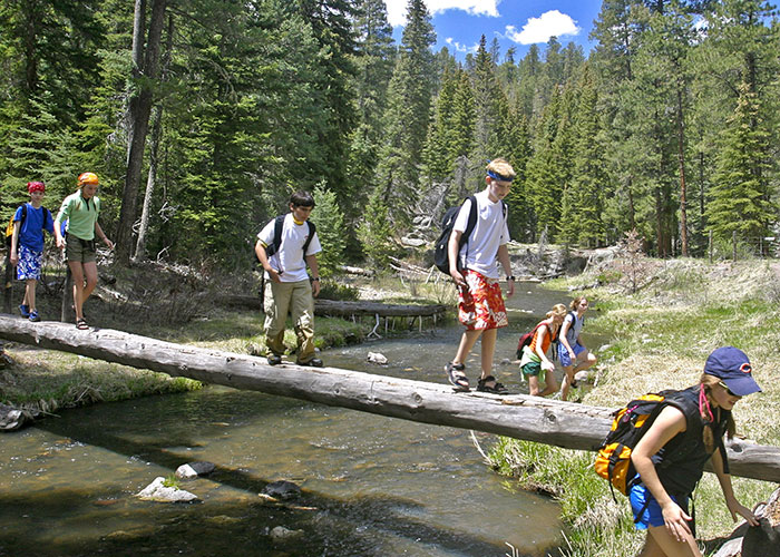 Montessori teens on a school trip spend time in nature.