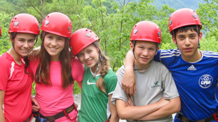 Montessori Secondary Level students wear helmets on a camping trip.