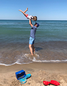 A father and daughter have fun together at the beach,
