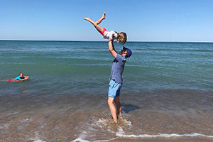 A father and daughter beat the summertime blues by keeping it simple at the beach.