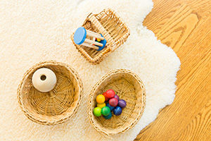 Colorful wooden Montessori infant toys in baskets