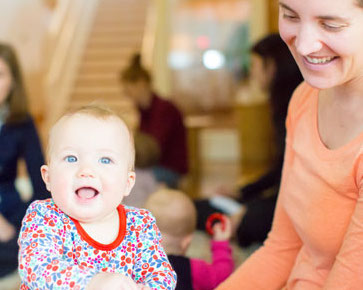 An infant and her mother enjoy a Montessori environment