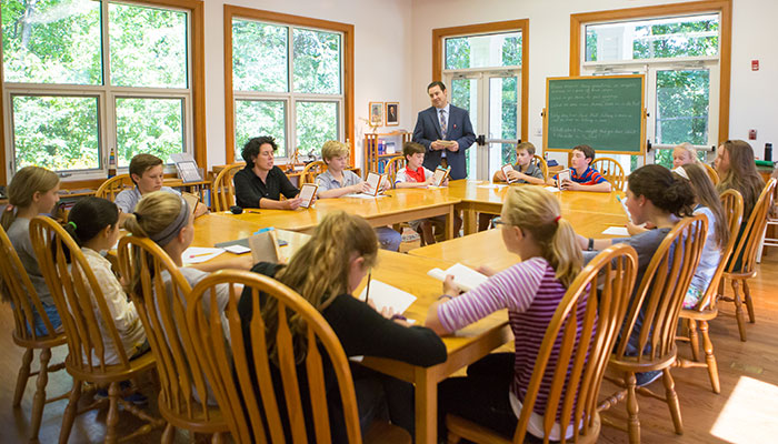 Students in a Montessori Secondary classroom engage in Socratic discussion
