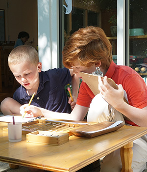 Montessori students work with golden beads to learn the foundations of currency