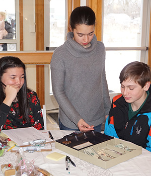 Montessori students manage the cash during a holiday fundraiser