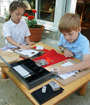 Students use real coins to learn about currency