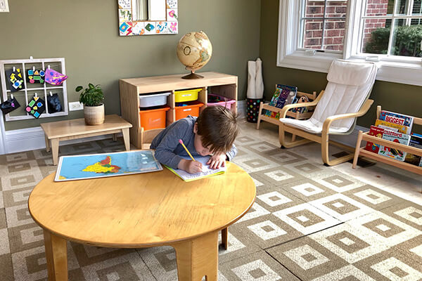 A child works in a Montessori homeschool environment