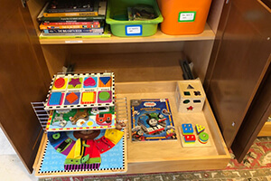 In a Montessori home shelves and cabinets are organized for children to be able to access materials independently