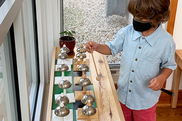 A Montessori Primary child works with the bells